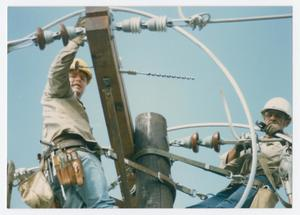 Primary view of object titled '[Two linemen on an electrical pole]'.