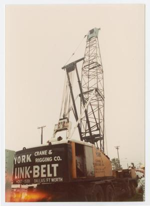 Primary view of object titled '[Close-up of crane moving old power plant equipment]'.