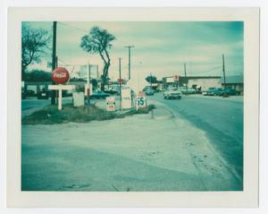 Primary view of object titled '[Signs in front of gas station on S. Elm Street]'.