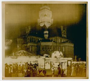 [Photograph of Ellis County Courthouse and Carnival at Night]