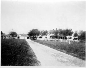 Primary view of object titled '[The dirt driveway leading to the George house]'.