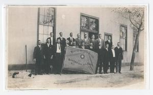 Primary view of object titled '[Photograph of Gesang Verein Group with 1893 Flag]'.