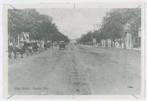 Primary view of object titled '[Photograph of Buggies on Main Street, Boerne, Texas]'.