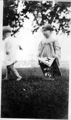 Primary view of object titled '[Two young children standing in a yard]'.