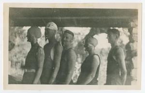 Primary view of object titled '[Photograph of Five Muddy-Faced Individuals]'.