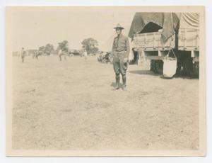 [Harry Bickler Stands, Guarding a Truck]