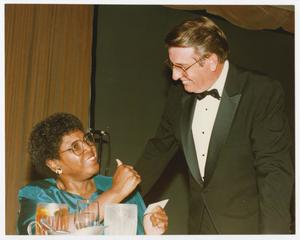 Primary view of object titled '[Barbara Jordan with a Man]'.