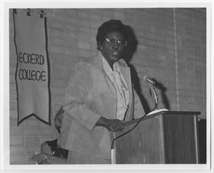 Primary view of object titled '[Barbara Jordan Standing at a Microphone]'.