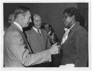 Primary view of object titled '[Barbara Jordan Speaks With Two Unidentified Men]'.
