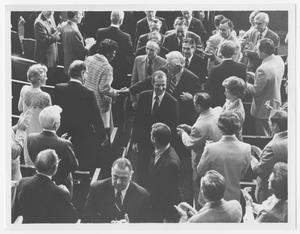 Primary view of object titled '[Carl Gustav Walks Down an Aisle in the Congressional Meeting Hall]'.