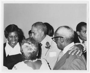 Primary view of object titled '[Barbara Jordan with a Group of Unidentified People]'.