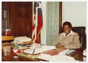 Primary view of object titled '[Barbara Jordan Sitting at Her Desk]'.