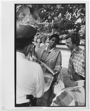 Primary view of object titled '[Barbara Jordan Shows a Man a Newspaper]'.