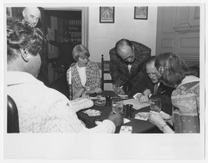 Primary view of object titled '[Barbara Jordan, Nancy Earl, and Two Unidenified Persons Play a Card Game]'.