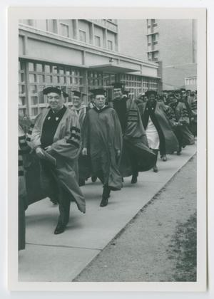 Primary view of object titled '[Barbara Jordan and Other Graduates Walk at Graduation]'.