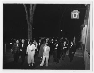 Primary view of object titled '[Attendees of the Parliamentary Conference Walk Down the Street]'.