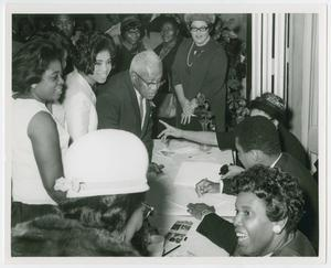 Primary view of object titled '[Barbara Jordan and Muhammad Ali Sign Autographs]'.