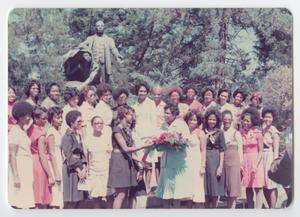 Primary view of object titled '[Barbara Jordan Being Handed a Bouquet of Flowers at the Tuskegee Institute]'.
