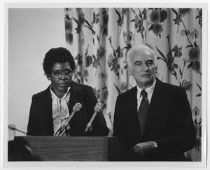 Primary view of object titled '[Barbara Jordan With a Man at a Podium]'.
