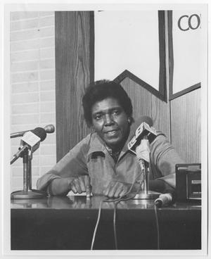 Primary view of object titled '[Barbara Jordan Sitting at Microphones]'.