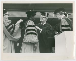 Primary view of object titled '[Barbara Jordan Being Awarded an Honorary Degree at Boston University]'.