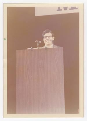 Primary view of object titled '[A Man Speaks at an Event]'.