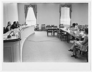 Primary view of object titled '[Barbara Jordan Sits Across From a Panel]'.