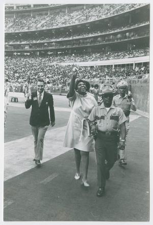 Primary view of object titled '[Barbara Jordan Waves to a Crowd]'.
