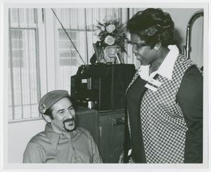 Primary view of object titled '[Barbara Jodan Speaks with a Patient of Houston Veterans Administration Hospital]'.