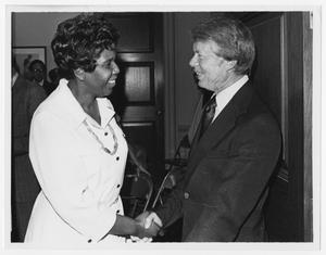 Primary view of object titled '[Barbara Jordan and President Jimmy Carter Shake Hands]'.