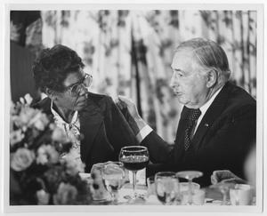 Primary view of object titled '[Barbara Jordan Sitting With a Man at a Table]'.