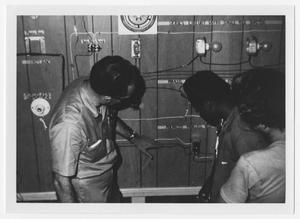 Primary view of object titled '[An Instructor Teaches Two Boys About Circuits]'.
