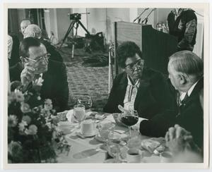 Primary view of object titled '[Barbara Jordan Sitting With Men at a Table]'.