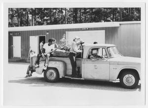 Primary view of object titled '[Four Boys Riding on the Back of a Truck]'.