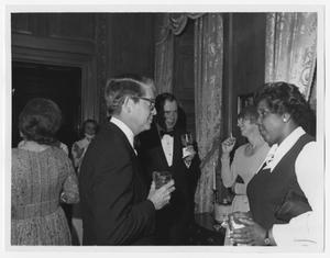 Primary view of object titled '[Barbara Jordan Speaks to an Unidentified Man]'.