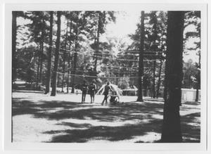 Primary view of object titled '[Three Persons Walk on a Volleyball Court]'.