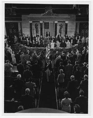 Primary view of object titled '[Three Men in Colonial Uniforms Walk Down an Aisle of Congress]'.
