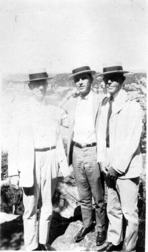 Primary view of object titled '[Albert P. George and two other men standing on a cliff]'.