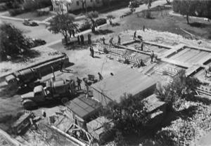 [Aerial View of the Construction Site and Cement Trucks]