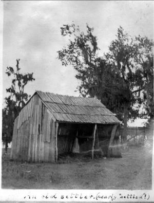 Primary view of object titled '[Wooden shack with front side completely missing]'.