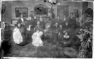Primary view of object titled '[A large family inside of a house]'.