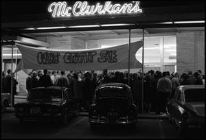 [Photograph of McClurkan's Storefront White Elephant Sale]