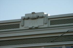 Primary view of object titled '[Sign on Top of Building]'.
