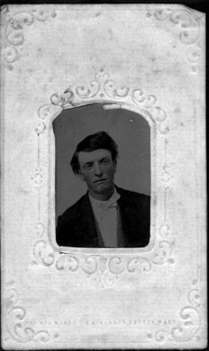 Primary view of object titled '[Bust tintype photograph of Eugene Arnold wearing a dark coat]'.