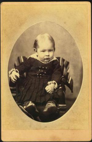 Primary view of object titled '[T.W. Davis as an infant, sitting in a chair]'.