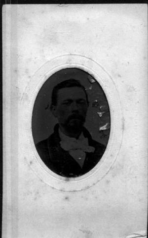 Primary view of object titled '[Bust photograph of a man wearing a dark coat and a white tie]'.