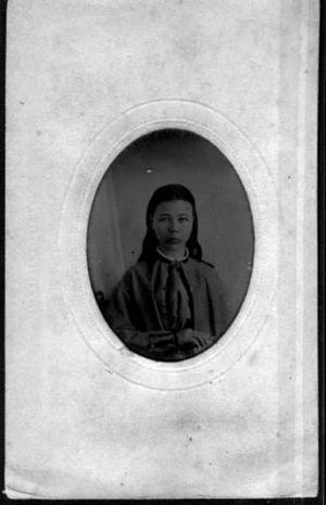 Primary view of object titled '[A young girl wearing a pale green sweater]'.