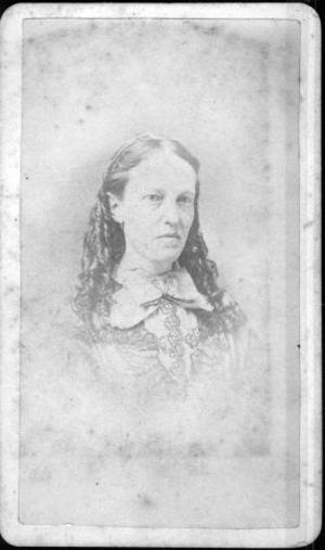 Primary view of object titled '[Bust photograph of an unidentified woman wearing a large bow]'.