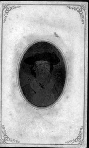 Primary view of object titled '[Bust photograph of an unidentified man wearing a dark coat and a white shirt]'.