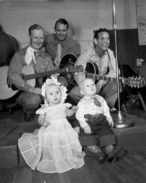 [Two Children With Three Members of a Band]